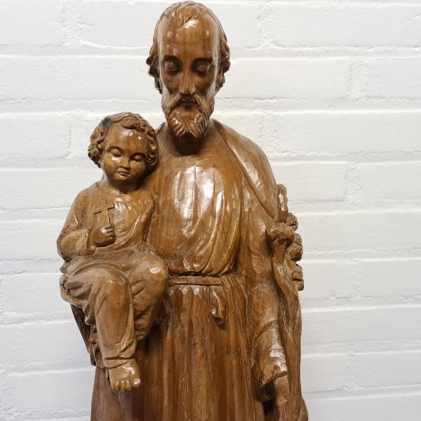 Houten sculpture Jozef met Jezus. Hoogte 61 cm