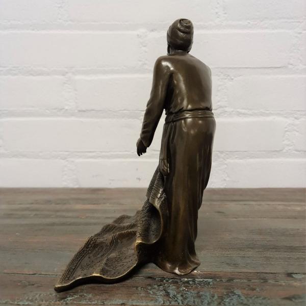 Gepatineerd bronzen sculpture van Perzen verkoper. Hoogte 21 cm